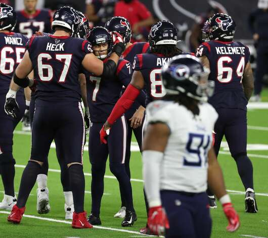 Houston Texans kicker Ka'imi Fairbairn (7) is embraced by offensive tackle Charlie Heck (67) after kicking a 51-yard field goal to to the game against the Tennessee Titans during the fourth quarter of an NFL football game at NRG Stadium on Sunday, Jan. 3, 2021, in Houston. Photo: Brett Coomer/Staff Photographer / © 2021 Houston Chronicle