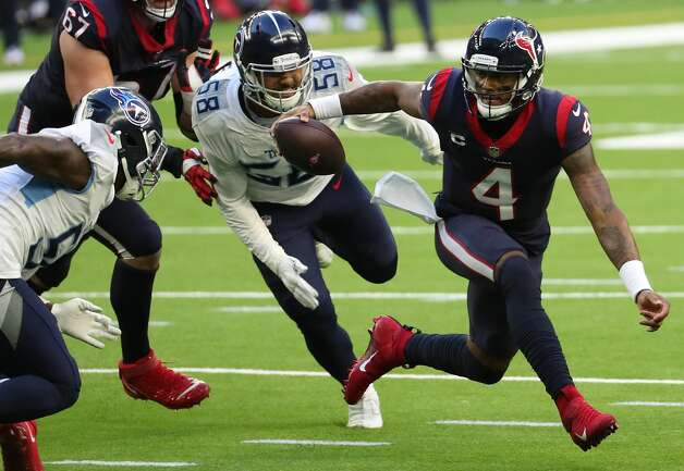Houston Texans quarterback Deshaun Watson (4) is forced to scramble and is chased down by Tennessee Titans outside linebacker Harold Landry (58) during the second quarter of an NFL football game at NRG Stadium on Sunday, Jan. 3, 2021, in Houston. Photo: Brett Coomer/Staff Photographer / © 2021 Houston Chronicle