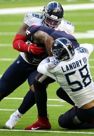 Houston Texans quarterback Deshaun Watson (4) is sacked by Tennessee Titans outside linebacker Harold Landry (58) and defensive end Jeffery Simmons (98) during the second quarter of an NFL football game at NRG Stadium on Sunday, Jan. 3, 2021, in Houston. Photo: Brett Coomer/Staff Photographer / © 2021 Houston Chronicle