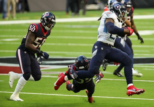 Tennessee Titans running back Derrick Henry (22) leaps past Houston Texans cornerback Keion Crossen (35) on a run around the end during the second quarter of an NFL football game at NRG Stadium on Sunday, Jan. 3, 2021, in Houston. Photo: Brett Coomer/Staff Photographer / © 2021 Houston Chronicle