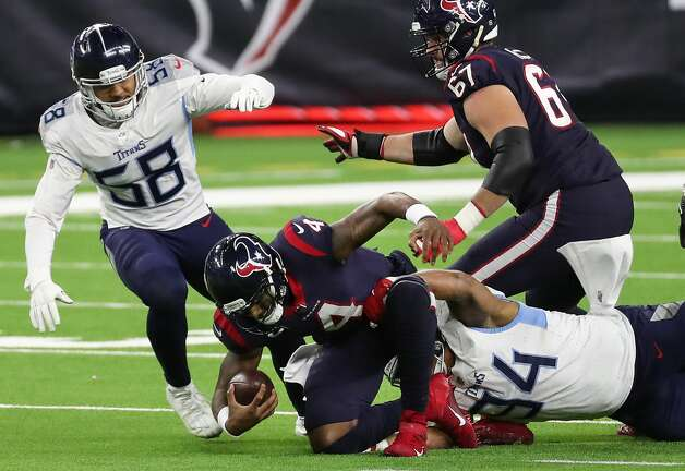 Houston Texans quarterback Deshaun Watson (4) is sacked by Tennessee Titans defensive end Jack Crawford (94) during the fourth quarter of an NFL football game at NRG Stadium on Sunday, Jan. 3, 2021, in Houston. Photo: Brett Coomer/Staff Photographer / © 2021 Houston Chronicle