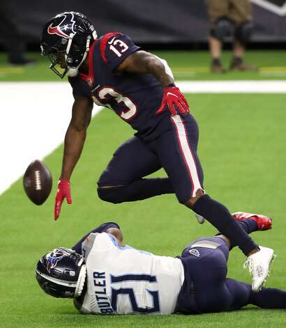 Tennessee Titans cornerback Malcolm Butler (21) breaks up a pass in the end zone intended for Houston Texans wide receiver Brandin Cooks (13) during the fourth quarter of an NFL football game at NRG Stadium on Sunday, Jan. 3, 2021, in Houston. Photo: Brett Coomer/Staff Photographer / © 2021 Houston Chronicle