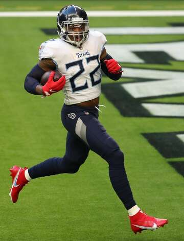 Tennessee Titans running back Derrick Henry (22) runs into the end zone after beating the Houston defense for a 52-yard touchdown run during the second quarter of an NFL football game at NRG Stadium on Sunday, Jan. 3, 2021, in Houston. Photo: Brett Coomer/Staff Photographer / © 2021 Houston Chronicle