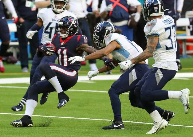 Houston Texans wide receiver Steven Mitchell (11) makes a catch for a first down on a fake punt against the Tennessee Titans during the second quarter of an NFL football game at NRG Stadium on Sunday, Jan. 3, 2021, in Houston. Photo: Brett Coomer/Staff Photographer / © 2021 Houston Chronicle