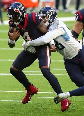 Houston Texans quarterback Deshaun Watson (4) is sacked by Tennessee Titans outside linebacker Harold Landry (58) during the second quarter of an NFL football game at NRG Stadium on Sunday, Jan. 3, 2021, in Houston. Photo: Brett Coomer/Staff Photographer / © 2021 Houston Chronicle
