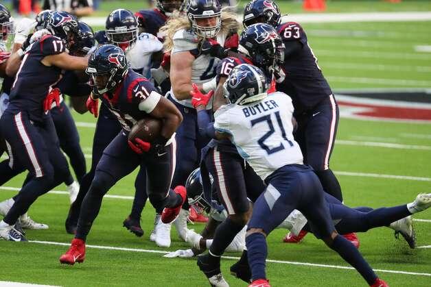 Houston Texans running back David Johnson (31) runs the ball against the Tennessee Titans during the second quarter of an NFL football game at NRG Stadium on Sunday, Jan. 3, 2021, in Houston. Photo: Brett Coomer/Staff Photographer / © 2021 Houston Chronicle