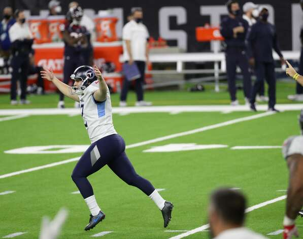 Tennessee Titans kicker Sam Sloman (2) celebrates his 37-yard game-winning field goal to beat the Houston Texans during the fourth quarter of an NFL football game at NRG Stadium on Sunday, Jan. 3, 2021, in Houston. Sloman's kick, that bounced off the upright and wend in, to give the Titans a 41-38 win and the AFC South title. Photo: Brett Coomer/Staff Photographer / © 2021 Houston Chronicle