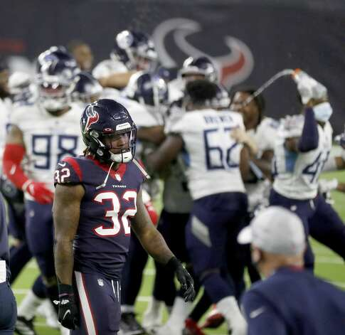 Houston Texans cornerback Lonnie Johnson (32) reacts as Tennessee Titans teammates surround kicker Sam Sloman (2) while they celebrated his winning field goal in the final seconds for the 41-38 win over the Houston Texans during the fourth quarter of an NFL football game Sunday, Jan. 3, 2021, at NRG Stadium in Houston. Photo: Karen Warren/Staff Photographer / © 2021 Houston Chronicle