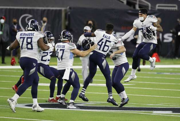 Tennessee Titans teammates surround kicker Sam Sloman (2) as they celebrated his winning field goal in the final seconds for the 41-38 win over the Houston Texans during the fourth quarter of an NFL football game Sunday, Jan. 3, 2021, at NRG Stadium in Houston. Photo: Karen Warren/Staff Photographer / © 2021 Houston Chronicle