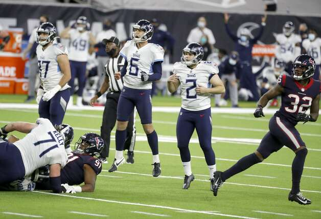 Tennessee Titans kicker Sam Sloman (2) and punter Brett Kern (6) celebrate the winning field goal in the final seconds for the 41-38 win over the Houston Texans during the fourth quarter of an NFL football game Sunday, Jan. 3, 2021, at NRG Stadium in Houston. Photo: Karen Warren/Staff Photographer / © 2021 Houston Chronicle