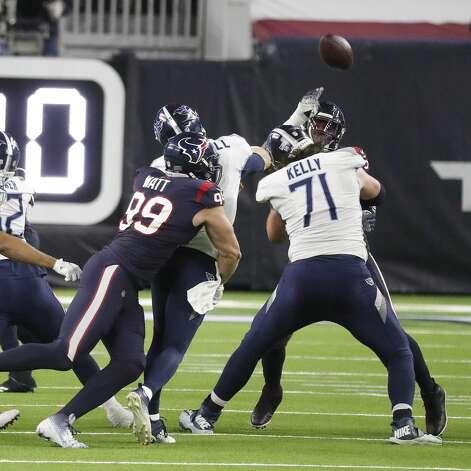 Houston Texans defensive end J.J. Watt (99) sacks Tennessee Titans quarterback Ryan Tannehill (17) during the fourth quarter of an NFL football game Sunday, Jan. 3, 2021, at NRG Stadium in Houston . Photo: Karen Warren/Staff Photographer / © 2021 Houston Chronicle