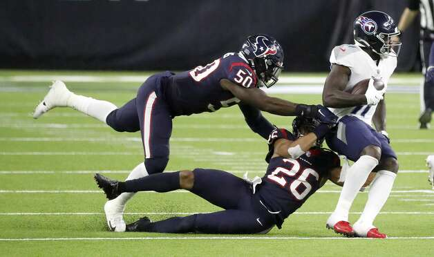 Tennessee Titans wide receiver A.J. Brown (11) is brought down by Houston Texans outside linebacker Tyrell Adams (50) and cornerback Vernon Hargreaves III (26) during the fourth quarter of an NFL football game Sunday, Jan. 3, 2021, at NRG Stadium in Houston . Photo: Karen Warren/Staff Photographer / © 2021 Houston Chronicle