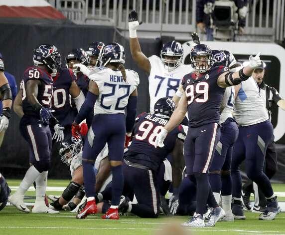 Houston Texans defensive end J.J. Watt (99) signals the Texans have possession during the fourth quarter of an NFL football game Sunday, Jan. 3, 2021, at NRG Stadium in Houston . Photo: Karen Warren/Staff Photographer / © 2021 Houston Chronicle