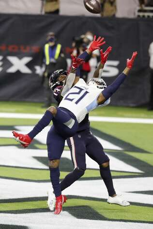 Tennessee Titans cornerback Malcolm Butler (21) battles Houston Texans wide receiver Brandin Cooks (13) for a pass in the end zone during the fourth quarter of an NFL football game Sunday, Jan. 3, 2021, at NRG Stadium in Houston . Photo: Karen Warren/Staff Photographer / © 2021 Houston Chronicle