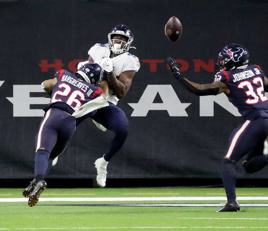 Tennessee Titans wide receiver Corey Davis (84) tries to catch a pass near the end zone against Houston Texans cornerbacks Vernon Hargreaves III (26) and Lonnie Johnson (32) during the fourth quarter of an NFL football game Sunday, Jan. 3, 2021, at NRG Stadium in Houston . Photo: Karen Warren/Staff Photographer / © 2021 Houston Chronicle