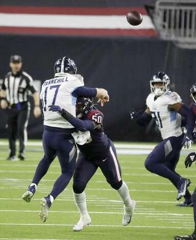 Houston Texans outside linebacker Tyrell Adams (50) tackles Tennessee Titans quarterback Ryan Tannehill (17) during the fourth quarter of an NFL football game Sunday, Jan. 3, 2021, at NRG Stadium in Houston . Photo: Karen Warren/Staff Photographer / © 2021 Houston Chronicle