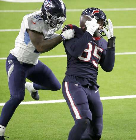 Houston Texans tight end Pharaoh Brown (85) catches a pass against Tennessee Titans linebacker David Long (51) for the touchdown during the fourth quarter of an NFL football game Sunday, Jan. 3, 2021, at NRG Stadium in Houston . Photo: Karen Warren/Staff Photographer / © 2021 Houston Chronicle