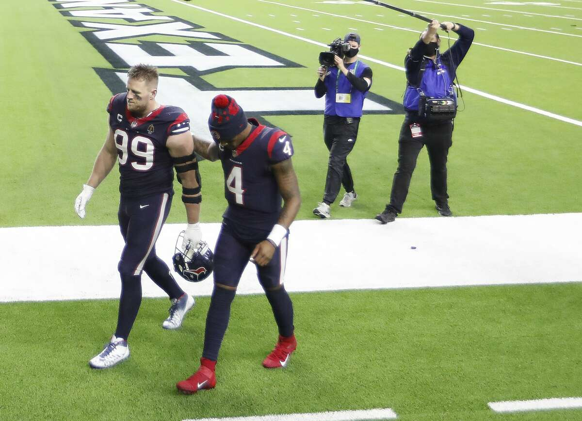 Houston Texans defensive end J.J. Watt (99) and quarterback Deshaun Watson (4) walk back to the locker room together after their 41-38 loss to the Tennessee Titans during the fourth quarter of an NFL football game Sunday, Jan. 3, 2021, at NRG Stadium in Houston .