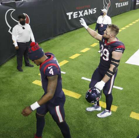 Houston Texans defensive end J.J. Watt (99) waves to fans as he and quarterback Deshaun Watson (4) walk back to the locker room together after their 41-38 loss to the Tennessee Titans during the fourth quarter of an NFL football game Sunday, Jan. 3, 2021, at NRG Stadium in Houston . Photo: Karen Warren/Staff Photographer / © 2021 Houston Chronicle