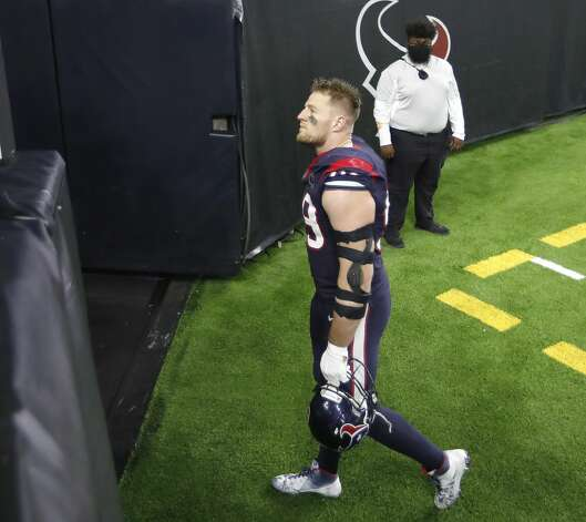 Houston Texans defensive end J.J. Watt (99) walks back to the locker room together after their 41-38 loss to the Tennessee Titans during the fourth quarter of an NFL football game Sunday, Jan. 3, 2021, at NRG Stadium in Houston . Photo: Karen Warren/Staff Photographer / © 2021 Houston Chronicle