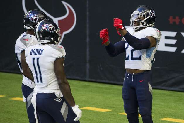 Tennessee Titans running back Derrick Henry (22) celebrates his 52-yard touchdown run against the Houston Texans during the first half of an NFL football game at NRG Stadium on Sunday, Jan. 3, 2021, in Houston. Photo: Brett Coomer/Staff Photographer / © 2021 Houston Chronicle