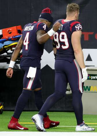 Houston Texans quarterback Deshaun Watson (4) and defensive end J.J. Watt (99) walk off the field after losing to the Tennessee Titans 41-38 in the final game of the season at NRG Stadium on Sunday, Jan. 3, 2021, in Houston. Photo: Brett Coomer/Staff Photographer / © 2021 Houston Chronicle