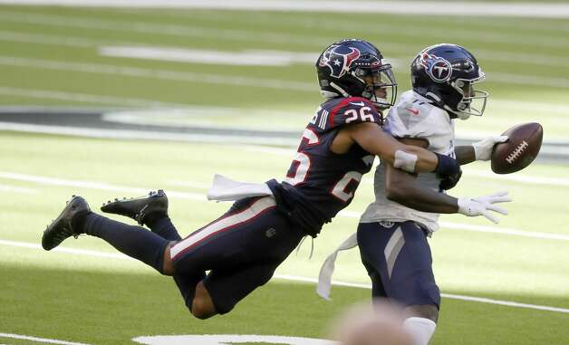 Tennessee Titans wide receiver A.J. Brown (11) catches a pass against Houston Texans cornerback Vernon Hargreaves III (26) during the first quarter of an NFL football game Sunday, Jan. 3, 2021, at NRG Stadium in Houston . Photo: Karen Warren/Staff Photographer / © 2021 Houston Chronicle