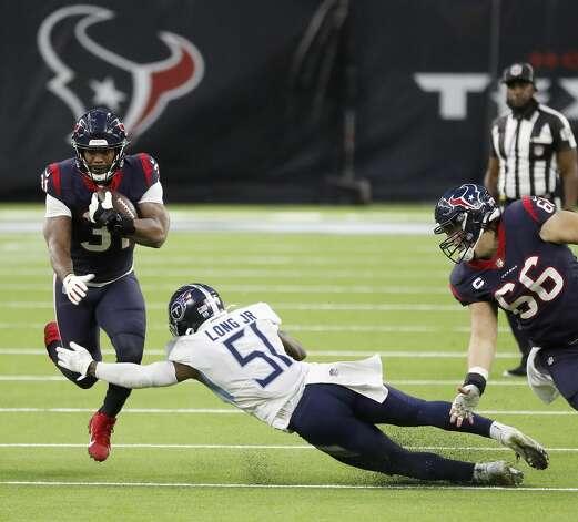 Houston Texans running back David Johnson (31) gains yardage as Tennessee Titans linebacker David Long (51) during the third quarter of an NFL football game Sunday, Jan. 3, 2021, at NRG Stadium in Houston . Photo: Karen Warren/Staff Photographer / © 2021 Houston Chronicle