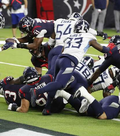 Houston Texans running back David Johnson (31) dives over the pack for the touchdown during the third quarter of an NFL football game Sunday, Jan. 3, 2021, at NRG Stadium in Houston . Photo: Karen Warren/Staff Photographer / © 2021 Houston Chronicle