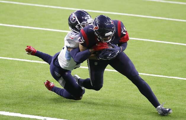 Houston Texans wide receiver Chad Hansen (17) catches the ball near the end zone against Tennessee Titans cornerback Malcolm Butler (21) during the third quarter of an NFL football game Sunday, Jan. 3, 2021, at NRG Stadium in Houston . Photo: Karen Warren/Staff Photographer / © 2021 Houston Chronicle