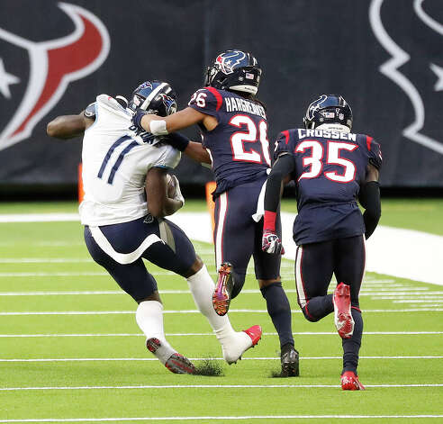 Houston Texans cornerback Vernon Hargreaves III (26) stops Tennessee Titans wide receiver A.J. Brown (11) after he caught a long pass during the third quarter of an NFL football game Sunday, Jan. 3, 2021, at NRG Stadium in Houston . Photo: Karen Warren/Staff Photographer / © 2021 Houston Chronicle