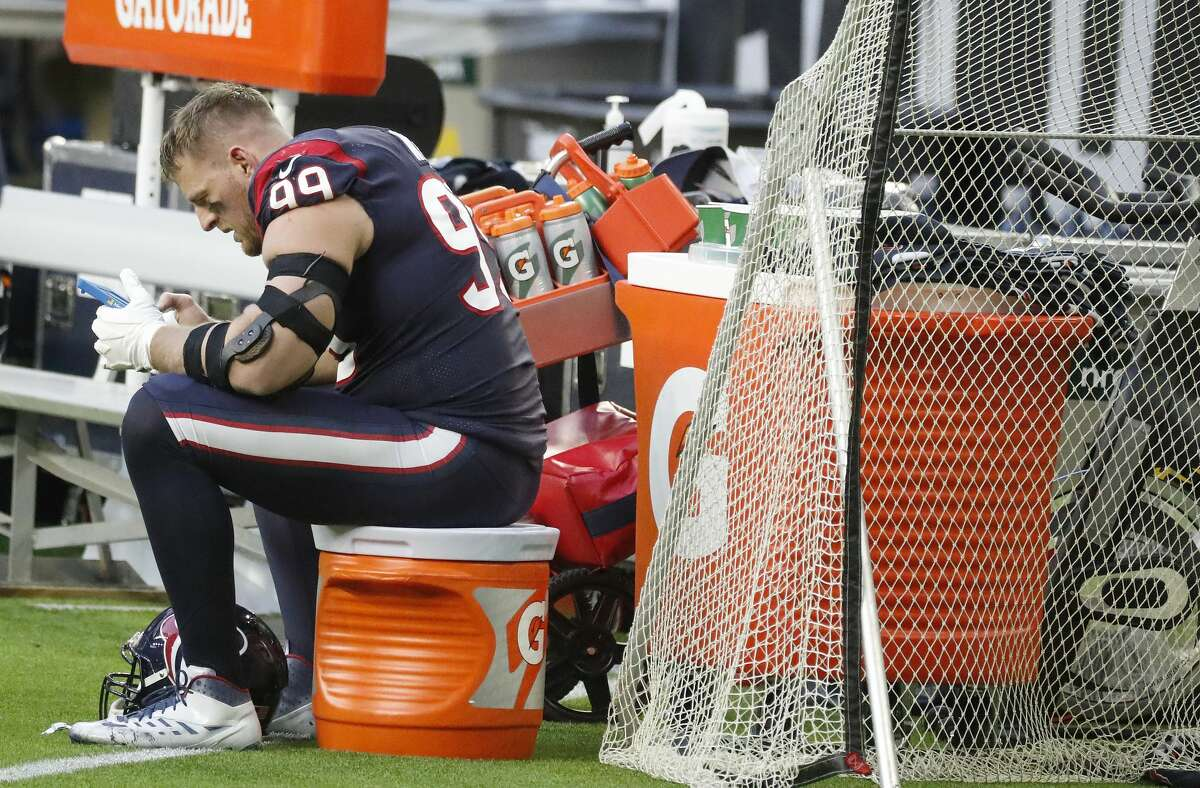 Houston Texans defensive end J.J. Watt (99) looks over plays on an iPad on the sideline during the third quarter of an NFL football game Sunday, Jan. 3, 2021, at NRG Stadium in Houston .