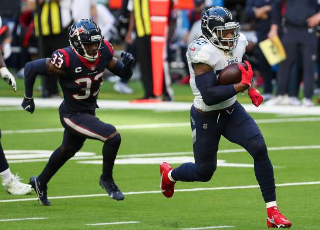 Tennessee Titans running back Derrick Henry (22) runs past Houston Texans safety A.J. Moore (33) on his way to a 52-yard touchdown run during the second quarter of an NFL football game at NRG Stadium on Sunday, Jan. 3, 2021, in Houston. Photo: Brett Coomer/Staff Photographer / © 2021 Houston Chronicle