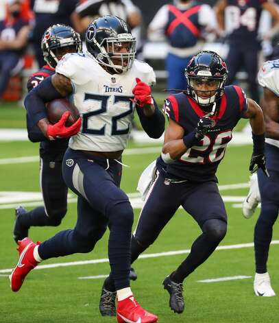 Tennessee Titans running back Derrick Henry (22) runs past Houston Texans defensive back Michael Thomas (28) on his way to a 52-yard touchdown run during the second quarter of an NFL football game at NRG Stadium on Sunday, Jan. 3, 2021, in Houston. Photo: Brett Coomer/Staff Photographer / © 2021 Houston Chronicle