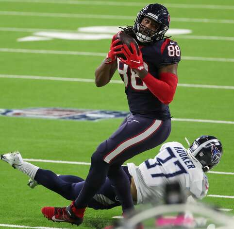 Houston Texans tight end Jordan Akins (88) makes a catch against Tennessee Titans strong safety Amani Hooker (37) during the fourth quarter of an NFL football game at NRG Stadium on Sunday, Jan. 3, 2021, in Houston. Photo: Brett Coomer/Staff Photographer / © 2021 Houston Chronicle