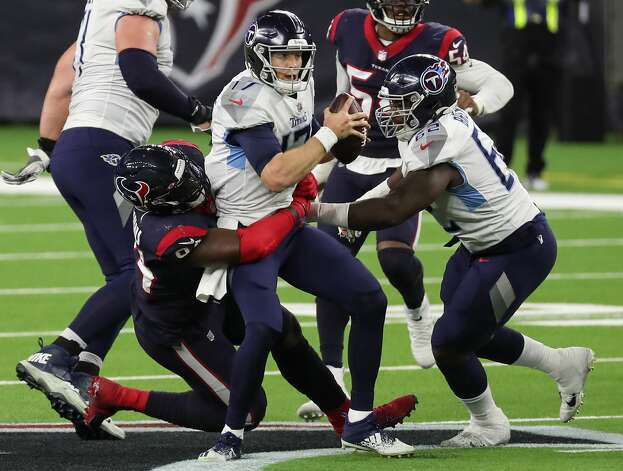 Tennessee Titans quarterback Ryan Tannehill (17) is sacked by Houston Texans defensive end Charles Omenihu (94) on fourth down during the fourth quarter of an NFL football game at NRG Stadium on Sunday, Jan. 3, 2021, in Houston. Photo: Brett Coomer/Staff Photographer / © 2021 Houston Chronicle