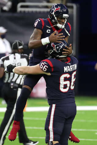 Houston Texans quarterback Deshaun Watson (4) leaps into the arms of center Nick Martin (66) after throwing a 20-yard touchdown pass to wide receiver Brandin Cooks during the third quarter of an NFL football game against the Tennessee Titans at NRG Stadium on Sunday, Jan. 3, 2021, in Houston. Photo: Brett Coomer/Staff Photographer / © 2021 Houston Chronicle