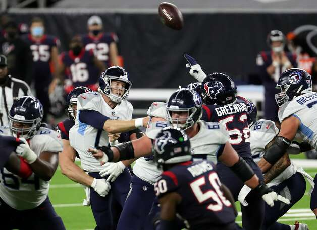 Tennessee Titans quarterback Ryan Tannehill (17) gets rid of the ball just as he is hit by Houston Texans defensive end J.J. Watt (99) for an incomplete pass during the fourth quarter of an NFL football game at NRG Stadium on Sunday, Jan. 3, 2021, in Houston. Photo: Brett Coomer/Staff Photographer / © 2021 Houston Chronicle