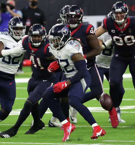 Houston Texans inside linebacker Zach Cunningham (41) knocks the ball out of the hands of Tennessee Titans running back Derrick Henry (22) for a fumble and a turnover during the third quarter of an NFL football game at NRG Stadium on Sunday, Jan. 3, 2021, in Houston. Photo: Brett Coomer/Staff Photographer / © 2021 Houston Chronicle