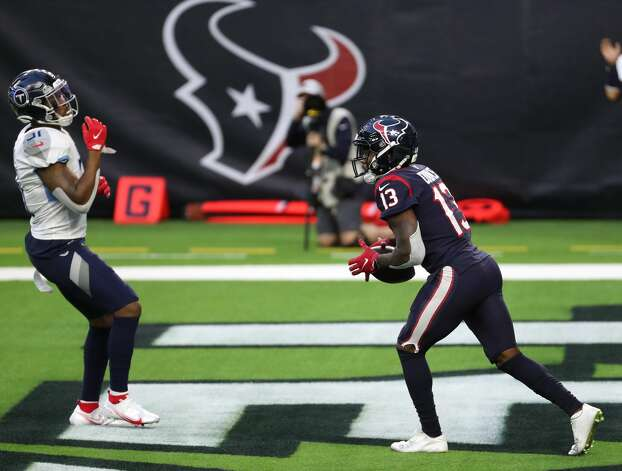 Houston Texans wide receiver Brandin Cooks (13) beats Tennessee Titans free safety Kevin Byard (31) for a 38-yard touchdown reception during the third quarter of an NFL football game against the Tennessee Titans at NRG Stadium on Sunday, Jan. 3, 2021, in Houston. Photo: Brett Coomer/Staff Photographer / © 2021 Houston Chronicle