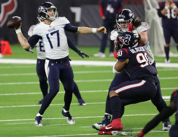 Tennessee Titans quarterback Ryan Tannehill (17) passes as he is pressured by Houston Texans defensive tackle Ross Blacklock (90) during the fourth quarter of an NFL football game at NRG Stadium on Sunday, Jan. 3, 2021, in Houston. Photo: Brett Coomer/Staff Photographer / © 2021 Houston Chronicle