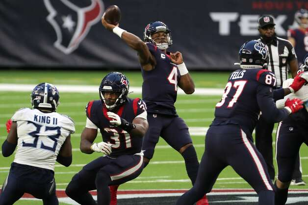 Houston Texans quarterback Deshaun Watson (4) throws a 38-yard touchdown pass to wide receiver Brandin Cooks during the third quarter of an NFL football game against the Tennessee Titans at NRG Stadium on Sunday, Jan. 3, 2021, in Houston. Photo: Brett Coomer/Staff Photographer / © 2021 Houston Chronicle