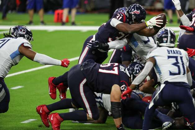 Houston Texans running back David Johnson (31) leaps over the goal line for a 1-yard touchdown run against the Tennessee Titans during the third quarter of an NFL football game at NRG Stadium on Sunday, Jan. 3, 2021, in Houston. Photo: Brett Coomer/Staff Photographer / © 2021 Houston Chronicle