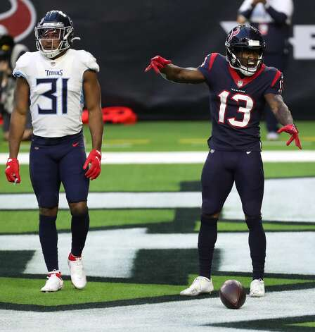 Houston Texans wide receiver Brandin Cooks (13) celebrates his 38-yard touchdown reception against Tennessee Titans free safety Kevin Byard (31) during the third quarter of an NFL football game against the Tennessee Titans at NRG Stadium on Sunday, Jan. 3, 2021, in Houston. Photo: Brett Coomer/Staff Photographer / © 2021 Houston Chronicle