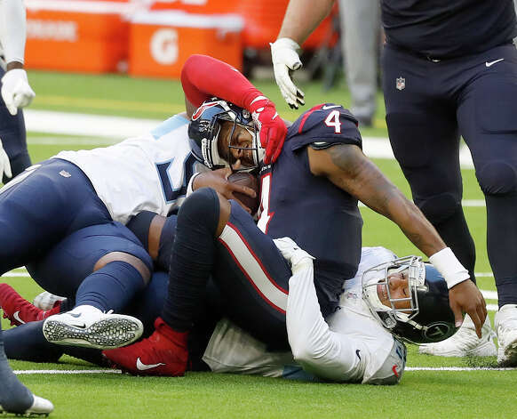 Houston Texans quarterback Deshaun Watson (4) is brought down by Tennessee Titans defensive end Jeffery Simmons (98) and outside linebacker Harold Landry (58) during the second quarter of an NFL football game Sunday, Jan. 3, 2021, at NRG Stadium in Houston . Photo: Karen Warren/Staff Photographer / © 2021 Houston Chronicle
