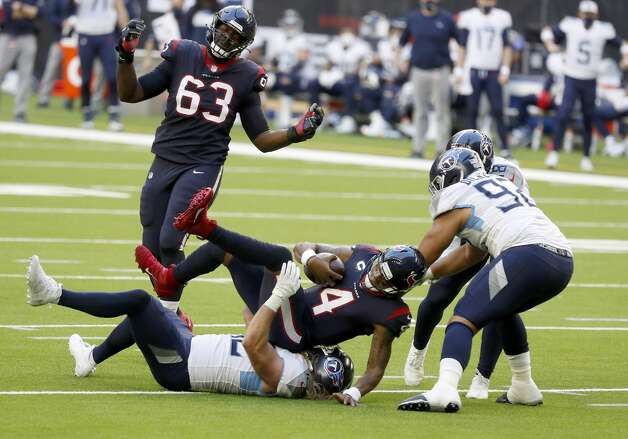 Houston Texans quarterback Deshaun Watson (4) is brought down by Tennessee Titans Brooks Reed (42) during the second quarter of an NFL football game Sunday, Jan. 3, 2021, at NRG Stadium in Houston . Photo: Karen Warren/Staff Photographer / © 2021 Houston Chronicle