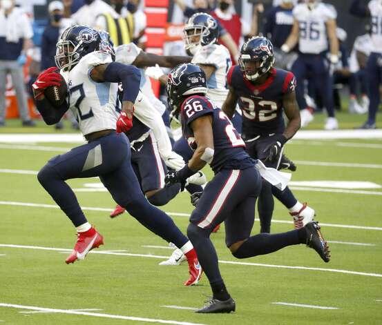Tennessee Titans running back Derrick Henry (22) runs the ball during the second quarter of an NFL football game Sunday, Jan. 3, 2021, at NRG Stadium in Houston . Photo: Karen Warren/Staff Photographer / © 2021 Houston Chronicle