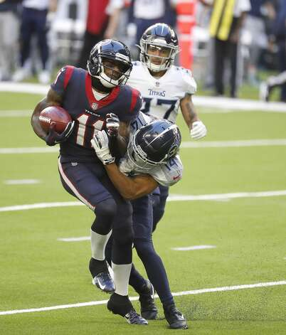 Houston Texans wide receiver Steven Mitchell (11) catches a pass against Tennessee Titans wide receiver Kalif Raymond (14) during the second quarter of an NFL football game Sunday, Jan. 3, 2021, at NRG Stadium in Houston . Photo: Karen Warren/Staff Photographer / © 2021 Houston Chronicle