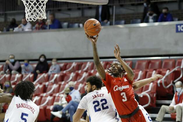 Houston guard DeJon Jarreau (3) takes a shot while SMU forward Isiah Jasey (22) defends during the first half of an NCAA college basketball game in Dallas, Sunday, Jan. 3, 2021. (AP Photo/Roger Steinman) Photo: Roger Steinman/Associated Press / Copyright 2021 The Associated Press. All rights reserved.
