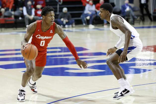Houston guard Marcus Sasser (0) drives toward the basket while SMU guard Darius McNeill (2) defends during the first half of an NCAA college basketball game in Dallas, Sunday, Jan. 3, 2021. (AP Photo/Roger Steinman) Photo: Roger Steinman/Associated Press / Copyright 2021 The Associated Press. All rights reserved.